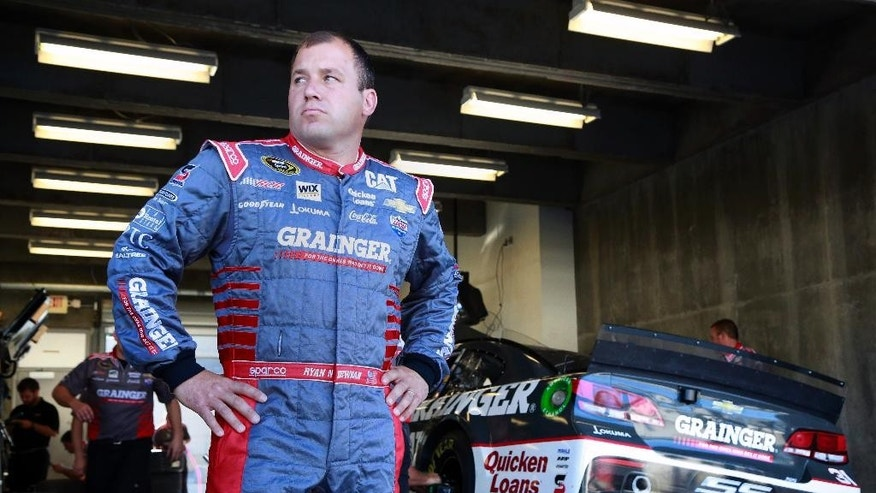 FILE - In this Friday, July 24, 2015 file photo, Sprint Cup Series driver Ryan Newman (31) waits as his crew works on his car during practice for the NASCAR Brickyard 400 auto race at Indianapolis Motor Speedway in Indianapolis. Ryan Newman held a Q & A with hundreds of middle school students in Delaware who peppered the only Sprint Cup driver with a college degree with questions about education and racing, Wednesday, Sept. 16, 2015. (AP Photo/R Brent Smith, File)