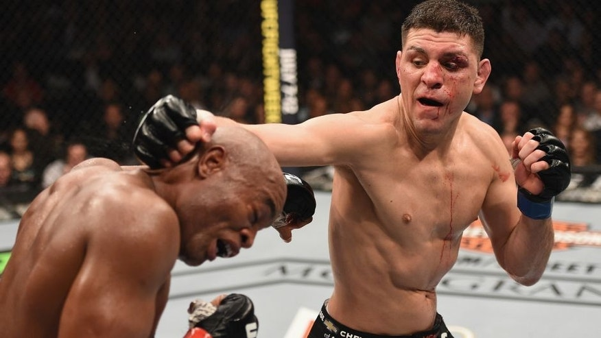 LAS VEGAS, NV - JANUARY 31: (R-L) Nick Diaz punches Anderson Silva of Brazil in their middleweight bout during the UFC 183 event at the MGM Grand Garden Arena on January 31, 2015 in Las Vegas, Nevada. (Photo by Josh Hedges/Zuffa LLC/Zuffa LLC via Getty Images)