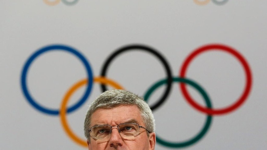 FILE - In this Monday, Aug. 3, 2015 file photo, International Olympic Committee President Thomas Bach speaks at a press conference after the 128th IOC session in Kuala Lumpur, Malaysia. The race is on for the 2024 Olympics, a five-city contest pitting four European bids against a two-time host from the United States. The IOC announced the official field of candidates Wednesday Sept. 16, 2015, and there were no surprises as the previously declared bidders were all on the list — Budapest, Hungary; Hamburg, Germany; Los Angeles; Paris and Rome. (AP Photo/Joshua Paul, File)