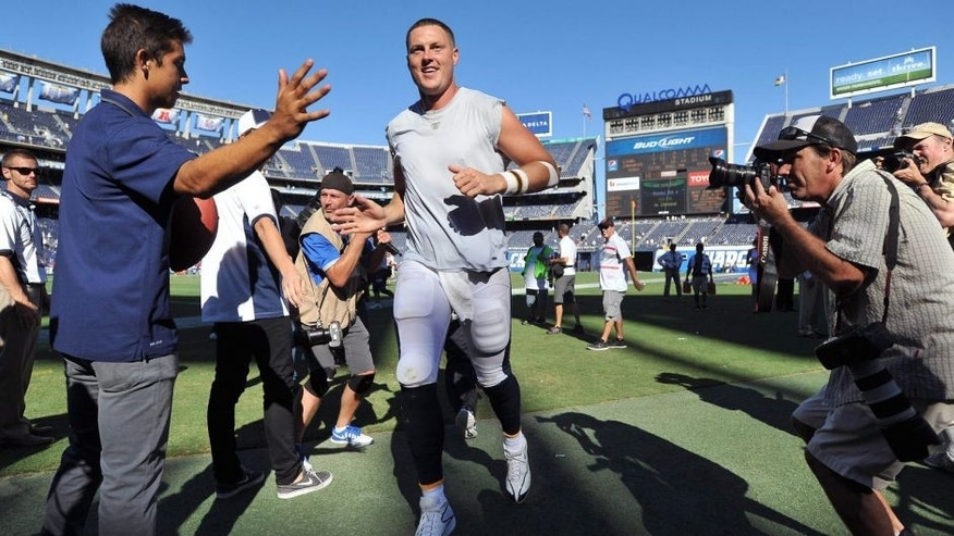 Sep 13, 2015; San Diego, CA, USA; San Diego Chargers quarterback Philip Rivers (center) runs off the field after the game against the Detroit Lions at Qualcomm Stadium. San Diego won 33-28. Mandatory Credit: Orlando Ramirez-USA TODAY Sports