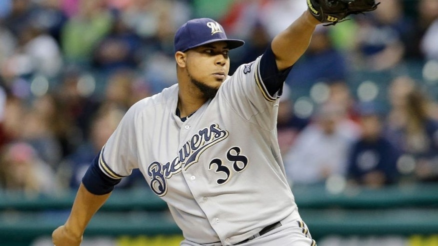 <p>Milwaukee Brewers starting pitcher Wily Peralta delivers in the first inning of a baseball game against the Cleveland Indians, Tuesday, Aug. 25, 2015, in Cleveland. (AP Photo/Tony Dejak)</p>