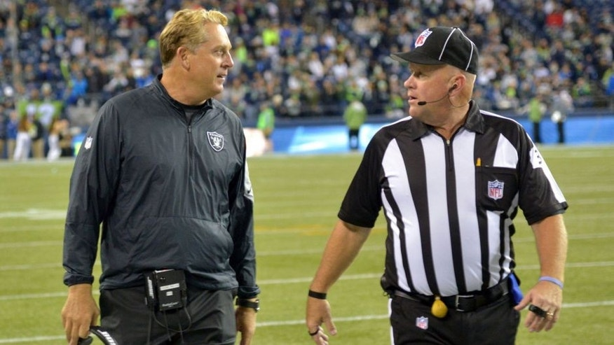 Sep 3, 2015; Seattle, WA, USA; Oakland Raiders coach Jack Del Rio (left) discusses a ruling by field judge Steve Zimmer (33) during the preseason game against the Seattle Seahawks at CenturyLink Field. Mandatory Credit: Kirby Lee-USA TODAY Sports