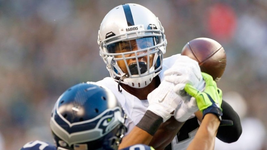 Sep 3, 2015; Seattle, WA, USA; Oakland Raiders safety Taylor Mays (27) breaks up a pass against the Seattle Seahawks during the first quarter at CenturyLink Field. Mandatory Credit: Joe Nicholson-USA TODAY Sports