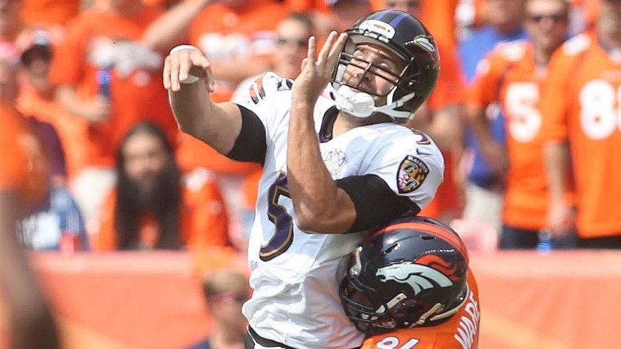 Sep 13, 2015; Denver, CO, USA; Baltimore Ravens quarterback Joe Flacco (5) throws the ball under pressure from Denver Broncos linebacker DeMarcus Ware (94) during the first half at Sports Authority Field at Mile High. Mandatory Credit: Chris Humphreys-USA TODAY Sports