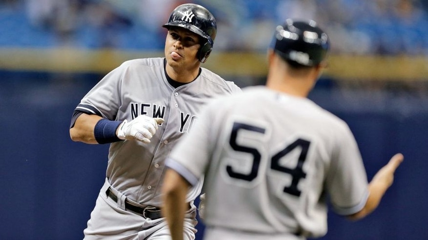 New York Yankees' Alex Rodriguez blows a bubble as he runs the bases after hitting a home run off Tampa Bay Rays starting pitcher Jake Odorizzi during the first inning of a baseball game Tuesday, Sept. 15, 2015, in St. Petersburg, Fla. (AP Photo/Chris O'Meara)