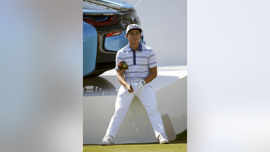 Rickie Fowler waits to tee off on the 18th during the pro-am round of the BMW Championship golf tournament at Conway Farms Golf Club, Wednesday, Sept. 16, 2015, in Lake Forest, Ill. (AP Photo/Charles Rex Arbogast)