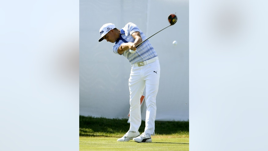 Rickie Fowler tees off on the 18th during the pro-am round of the BMW Championship golf tournament at Conway Farms Golf Club, Wednesday, Sept. 16, 2015, in Lake Forest, Ill. (AP Photo/Charles Rex Arbogast)