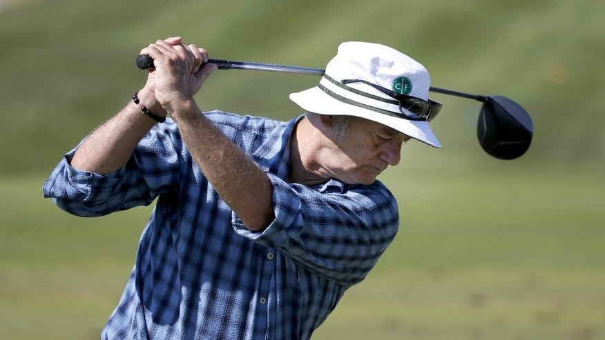 Actor Bill Murray practices on the driving range during the pro-am round of the BMW Championship golf tournament at Conway Farms Golf Club, Wednesday, Sept. 16, 2015, in Lake Forest, Ill. (AP Photo/Charles Rex Arbogast)