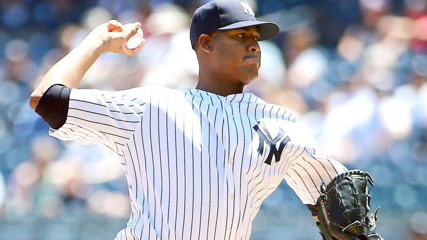 Jun 24, 2015; Bronx, NY, USA; New York Yankees starting pitcher Ivan Nova (47) throws a pitch against the Philadelphia Phillies at Yankee Stadium. Mandatory Credit: Andy Marlin-USA TODAY Sports