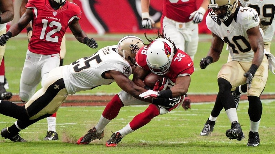 Sep 13, 2015; Glendale, AZ, USA; Arizona Cardinals running back Andre Ellington (38) is tackled by New Orleans Saints free safety Rafael Bush (25) during the first half at University of Phoenix Stadium. Mandatory Credit: Matt Kartozian-USA TODAY Sports