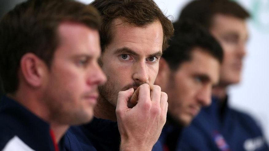 Britain's tennis star  Andy Murray, centre, looks on during press conference in Glasgow Scotland Wednesday Sept. 16, 2015. Britain play Australia in a Davis Cup semifinal starting on Friday. (Andrew Milligan/PA via AP) UNITED KINGDOM OUT