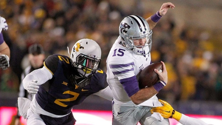 MORGANTOWN, WV - NOVEMBER 20: Jake Waters #15 of the Kansas State Wildcats rushes against Brandon Golson #2 and Karl Joseph #8 of the West Virginia Mountaineers in the second quarter during the game on November 20, 2014 at Mountaineer Field in Morgantown, West Virginia. (Photo by Justin K. Aller/Getty Images)