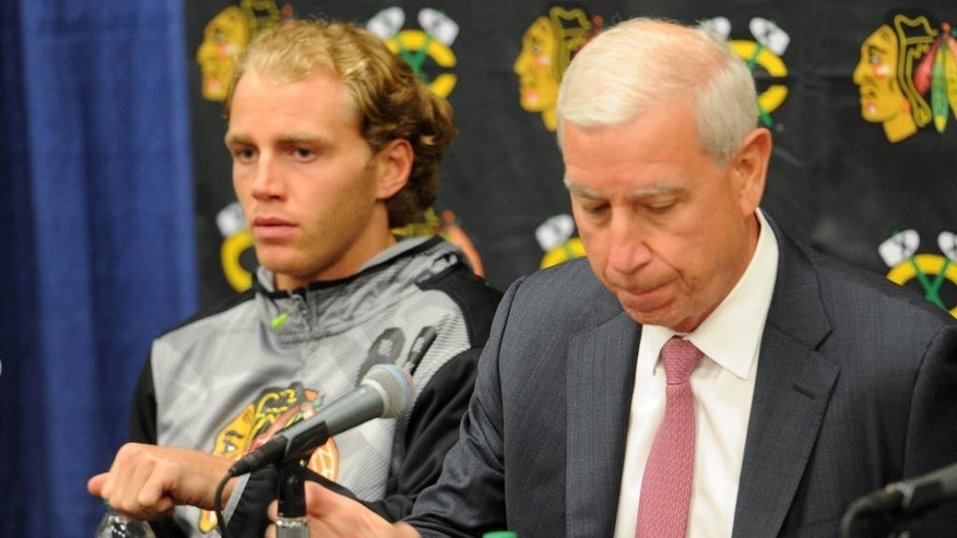 Chicago Blackhawks Patrick Kane, left, and John McDonough wait to answer questions during a media availability on the first day of NHL hockey training camp at the Compton Family Ice Center on the campus of the University of Notre Dame in South Bend, Ind., Thursday Sept. 17, 2015 (AP Photo/Joe Raymond)