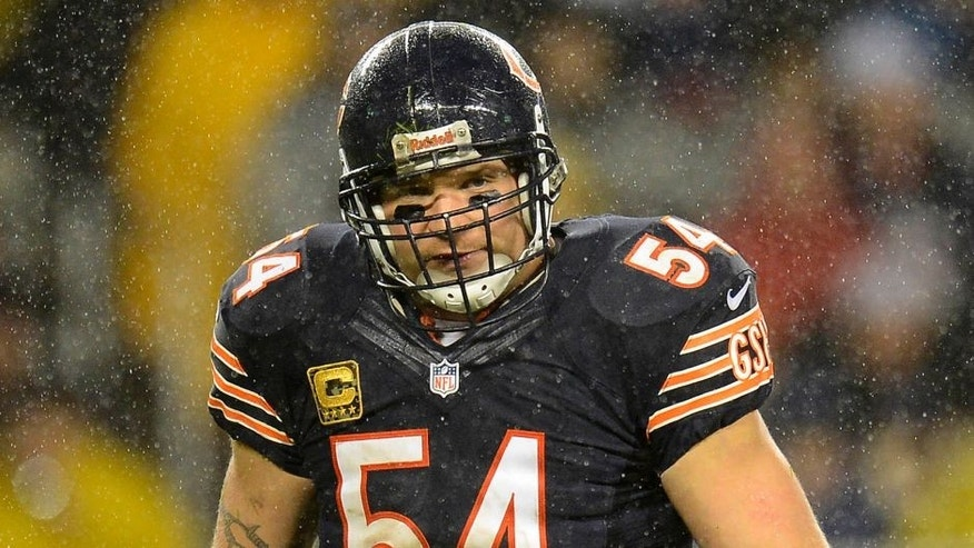 Nov 11, 2012; Chicago, IL, USA; Chicago Bears middle linebacker Brian Urlacher (54) reacts after making a play against the Houston Texans during the second quarter at Soldier Field. Mandatory Credit: Mike DiNovo-USA TODAY Sports