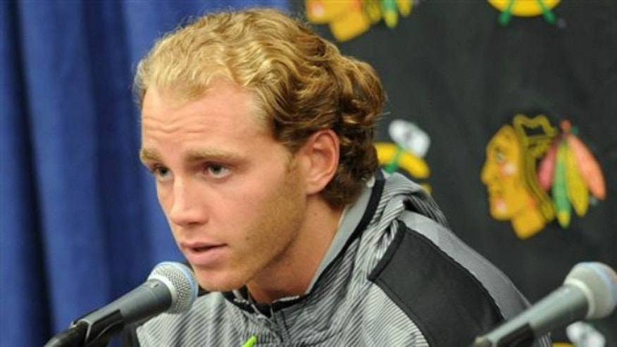 Sept. 17, 2015: Chicago Blackhawks' Patrick Kane answers a question during a media availability on the first day of NHL hockey training camp at the Compton Family Ice Center on the campus of the University of Notre Dame in South Bend, Ind.