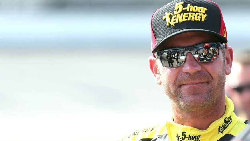 BROOKLYN, MI - AUGUST 14: Clint Bowyer, driver of the #15 5-Hour Energy Toyota, stands on the grid during qualifying for the NASCAR Sprint Cup Series Pure Michigan 400 at Michigan International Speedway on August 14, 2015 in Brooklyn, Michigan. (Photo by Jerry Markland/Getty Images)