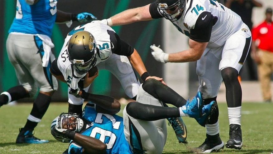 Sep 13, 2015; Jacksonville, FL, USA; Carolina Panthers defensive end Mario Addison (97) drags down Jacksonville Jaguars quarterback Blake Bortles (5) for a sack in the fourth quarter of their game at EverBank Field. The Carolina Panthers won 20-9. Mandatory Credit: Phil Sears-USA TODAY Sports