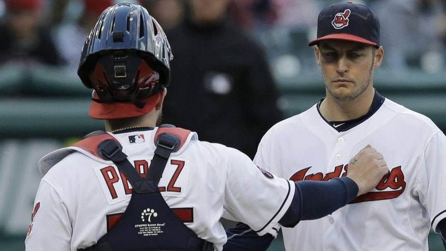 Cleveland Indians catcher Roberto Perez, left, talks with starting pitcher Trevor Bauer in the fourth inning of the second game of a baseball doubleheader against the Detroit Tigers