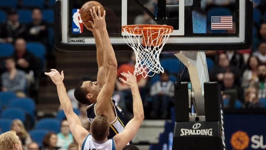 <p>Mar 30, 2015; Minneapolis, MN, USA; Utah Jazz center Rudy Gobert (27) dunks in the first quarter against the Minnesota Timberwolves at Target Center. Mandatory Credit: Brad Rempel-USA TODAY Sports</p>