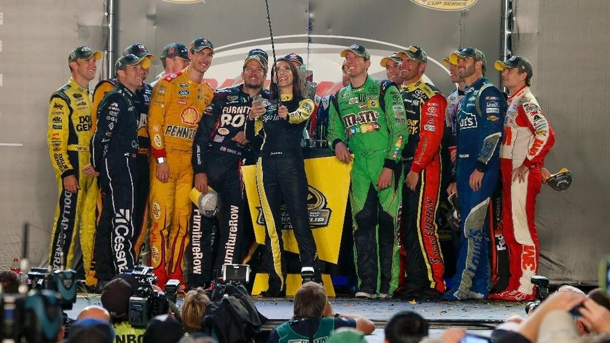 NASCAR Sprint Cup Drivers take a selfie with Miss Sprint Cup Juliana White after making the Chase for the Sprint Cup during the Post Race Party after the NASCAR Sprint Cup Series Federated Auto Parts 400 at Richmond International Raceway Saturday, Sept. 12, 2015 in Richmond, Va.  (Brian Lawdermilk/NASCAR via AP)