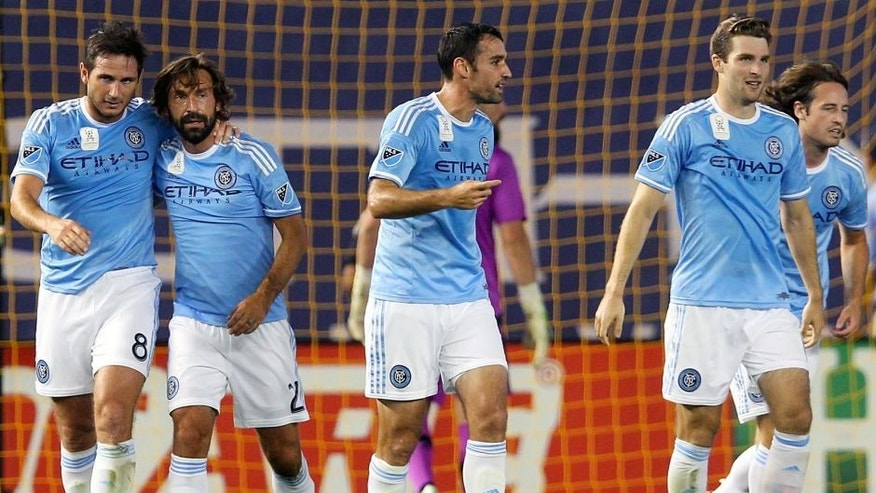 Sep 16, 2015; New York, NY, USA; New York City FC midfielder Frank Lampard (8) and New York City FC midfielder Andrea Pirlo (21) celebrate Lampard's goal against Toronto FC during the first half at Yankee Stadium. Mandatory Credit: Brad Penner-USA TODAY Sports