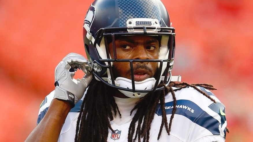 KANSAS CITY, MO - AUGUST 21: Cornerback Richard Sherman #25 of the Seattle Seahawks warms up prior to the start of the preaseason game against the Kansas City Chiefs at Arrowhead Stadium on August 21, 2015 in Kansas City, Missouri. (Photo by Jamie Squire/Getty Images)