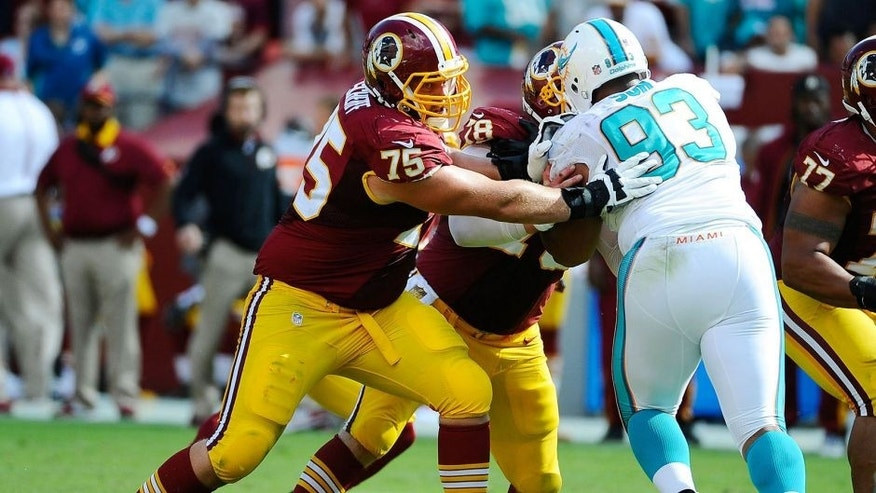 Sep 13, 2015; Landover, MD, USA; Washington Redskins offensive tackle Brandon Scherff (75) blocks Miami Dolphins defensive tackle Ndamukong Suh (93) during the second half at FedEx Field. Mandatory Credit: Brad Mills-USA TODAY Sports