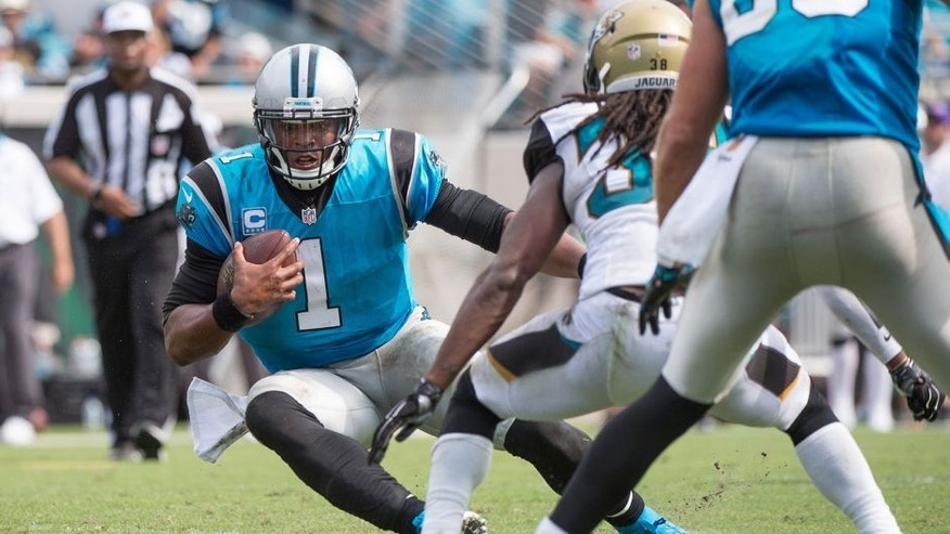 Sep 13, 2015; Jacksonville, FL, USA; Carolina Panthers quarterback Cam Newton (1) runs with the ball against the Jacksonville Jaguars during the second half at EverBank Field. The Panthers defeat the Jaguars 20-9. Mandatory Credit: Jerome Miron-USA TODAY Sports