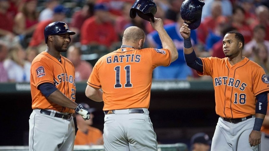 Sep 16, 2015; Arlington, TX, USA; Houston Astros first baseman Chris Carter (23) and designated hitter Evan Gattis (11) and third baseman Luis Valbuena (18) celebrate Gattis' hitting a two run home run against the Texas Rangers during the eighth inning at Globe Life Park in Arlington. The Rangers defeat the Astros 14-3. Mandatory Credit: Jerome Miron-USA TODAY Sports