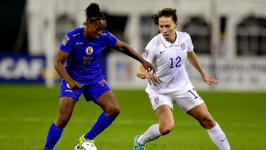 WASHINGTON, DC - OCTOBER 20: Samantha Brand #14 of Haiti battles for the ball against Lauren Holiday #12 of the United States in the first half during the 2014 CONCACAF Women's Championship at RFK Stadium on October 20, 2014 in Washington, DC. (Photo by Patrick McDermott/Getty Images)