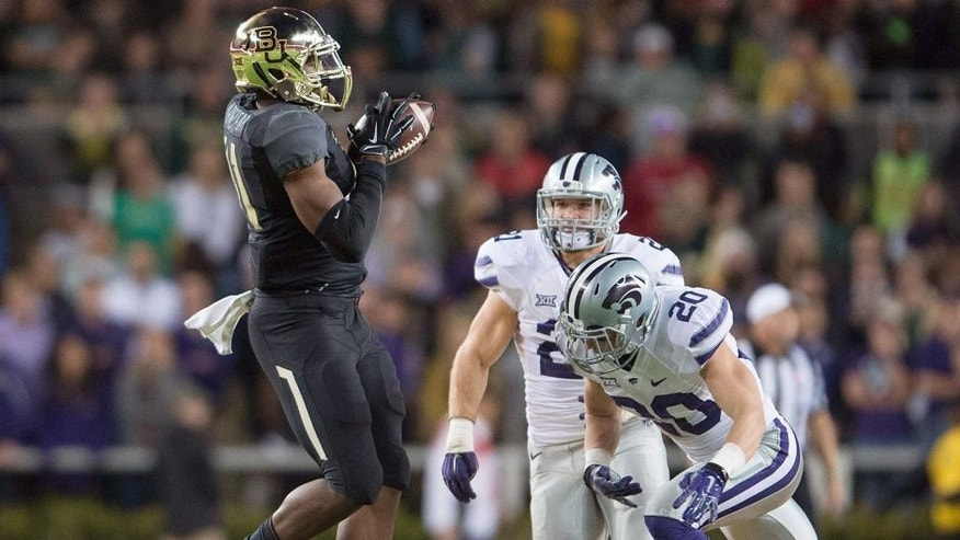 Dec 6, 2014; Waco, TX, USA; Baylor Bears tight end Tre'Von Armstead (41) catches a pass for a first down against the Kansas State Wildcats during the first quarter at McLane Stadium. Mandatory Credit: Jerome Miron-USA TODAY Sports