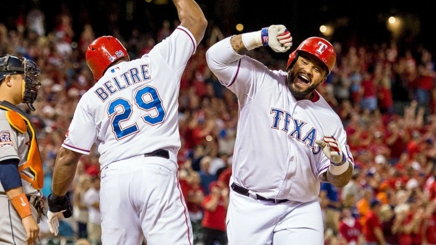 Sep 14, 2015; Arlington, TX, USA; Texas Rangers third baseman Adrian Beltre (29) and designated hitter Prince Fielder (84) celebrate Fielder's two run home run during the eighth inning against the Houston Astros at Globe Life Park in Arlington. The Rangers defeat the Astros 5-3. Mandatory Credit: Jerome Miron-USA TODAY Sports