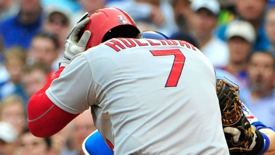 CHICAGO, IL - SEPTEMBER 18: Matt Holliday #7 of the St. Louis Cardinals holds his head after being hit by a pitch against the Chicago Cubs during the fifth inning on September 18, 2015 at Wrigley Field in Chicago, Illinois. (Photo by David Banks/Getty Images)