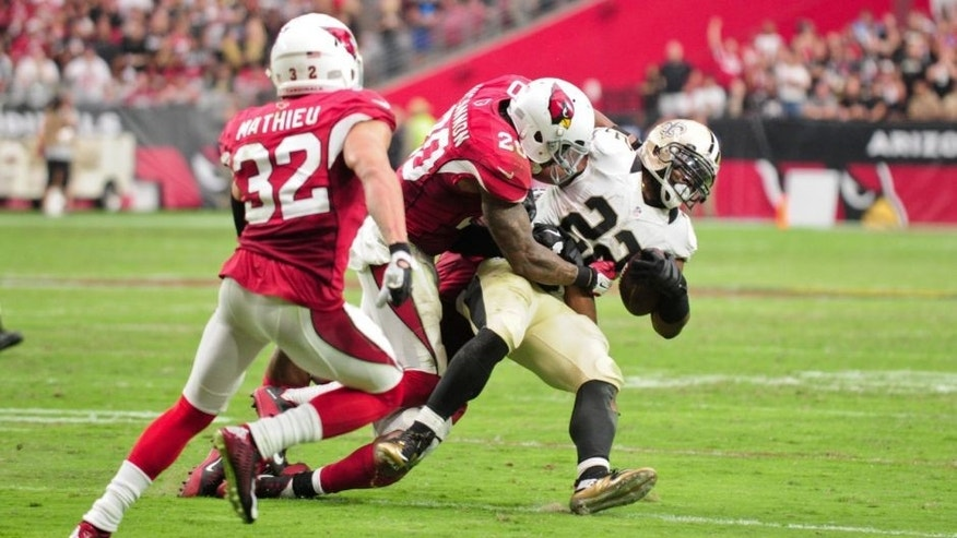 Sep 13, 2015; Glendale, AZ, USA; New Orleans Saints running back Mark Ingram (22) is tackled by Arizona Cardinals strong safety Deone Bucannon (20) as free safety Tyrann Mathieu (32) defends during the second half at University of Phoenix Stadium. Mandatory Credit: Matt Kartozian-USA TODAY Sports