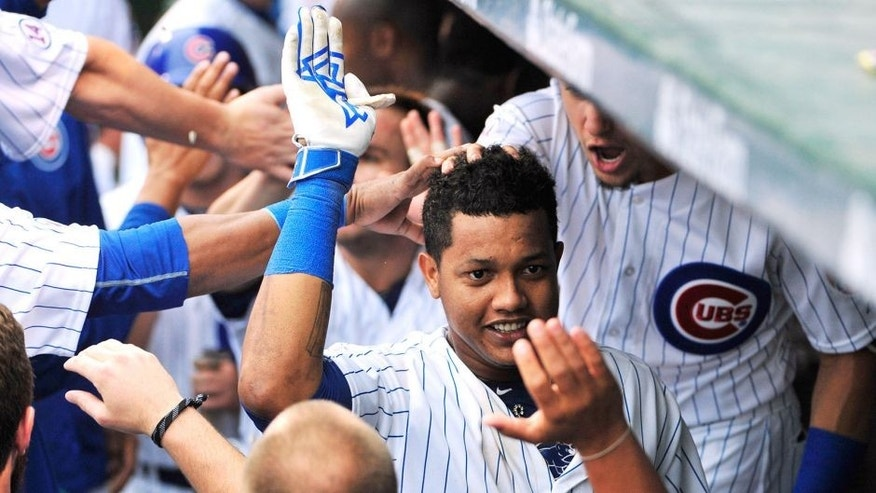 CHICAGO, IL - SEPTEMBER 18: Starlin Castro (C) of the Chicago Cubs is greeted by his teammates after hitting a two-run home run St. Louis Cardinals during the fifth inning on September 18, 2015 at Wrigley Field in Chicago, Illinois. (Photo by David Banks/Getty Images)