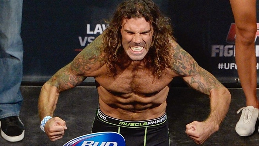 Clay 'The Carpenter' Guida steps on the scale during the UFC Fight Night weigh-in event at the SAP Center on July 25, 2014 in San Jose, California. (Photo by Jeff Bottari/Zuffa LLC/Zuffa LLC via Getty Images)