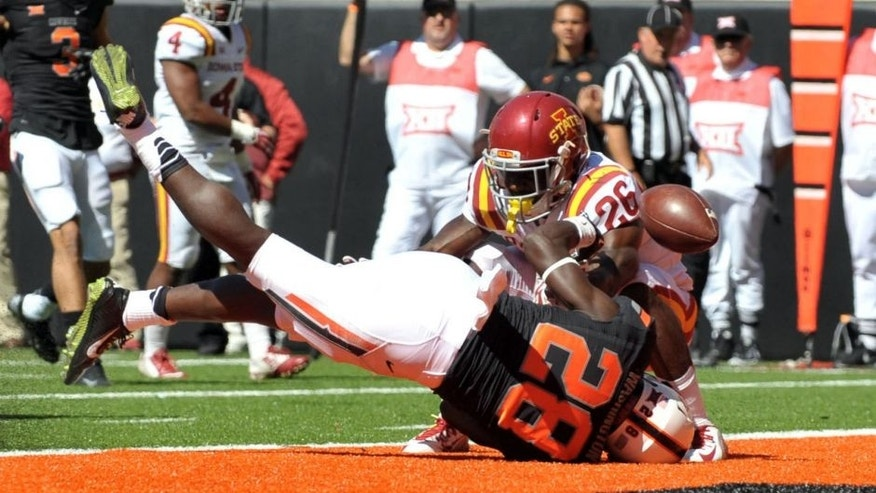 Oct 4, 2014; Stillwater, OK, USA; Oklahoma State Cowboys wide receiver James Washington (28) looses the ball at the goal line as Iowa State Cyclones defensive back Qujuan Floyd (26) defends during the second half at Boone Pickens Stadium. Oklahoma won 37-20. Mandatory Credit: Denny Medley-USA TODAY Sports