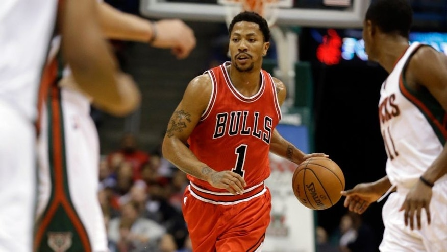 <p>Chicago Bulls' Derrick Rose brings the ball up the court during the first half of an NBA basketball game against the Milwaukee Bucks Wednesday, Nov. 5, 2014, in Milwaukee. (AP Photo/Morry Gash)</p>