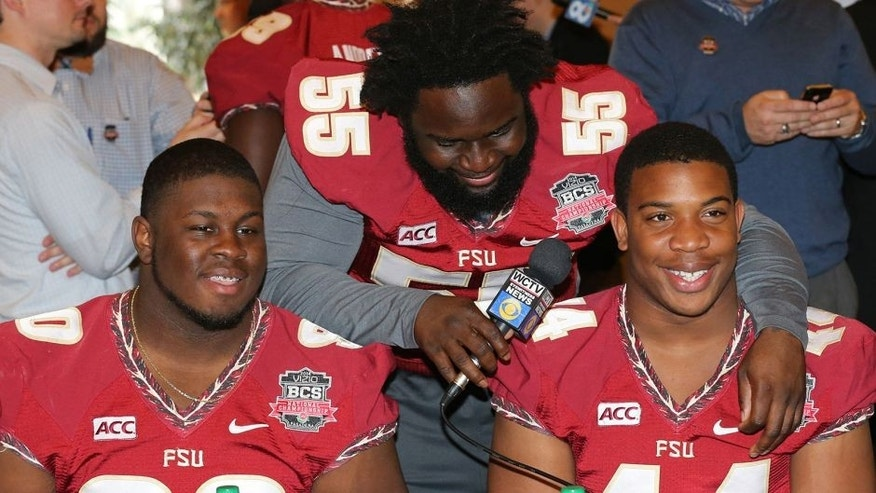 Jan 4, 2014; Newport Beach, CA, USA; Florida State Seminoles lineman Ira Denson (55) interviews his teammates defensive tackle Eddie Goldman (90) and defensive end DeMarcus Walker (44) during Media Day at Newport Beach Marriott. Mandatory Credit: Matthew Emmons-USA TODAY Sports
