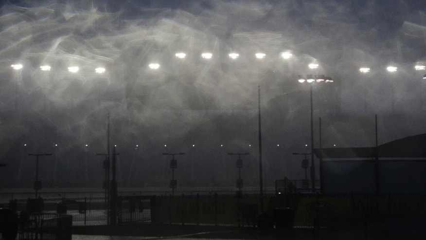 Empty grandstands are seen during a rain delay in qualifying for the NASCAR Camping World Truck Series auto race at Chicagoland Speedway, Friday, Sept. 18, 2015, in Joliet, Ill. (AP Photo/Nam Y. Huh)