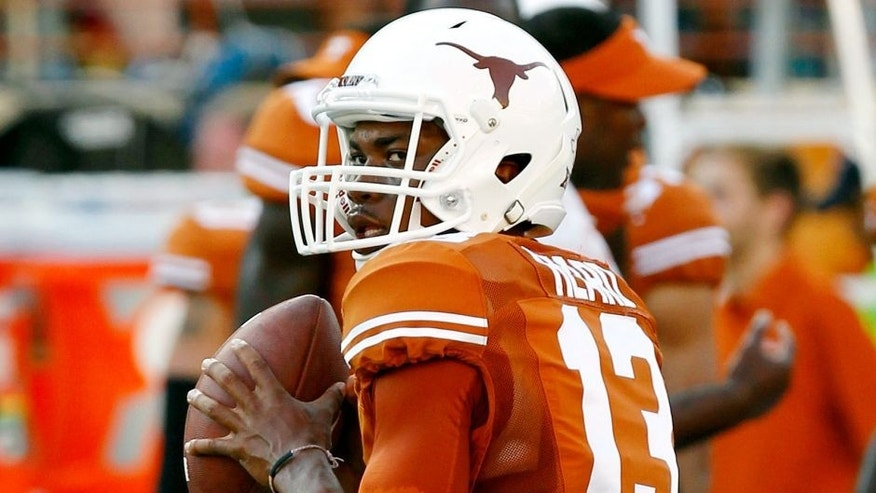 AUSTIN, TX - SEPTEMBER 6: Jerrod Heard #13 of the Texas Longhorns passes during pre game warmups before playing the BYU Cougars on September 6, 2014 at Darrell K Royal-Texas Memorial Stadium in Austin, Texas. (Photo by Chris Covatta/Getty Images)