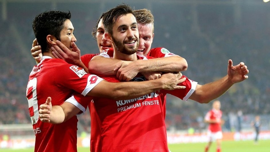 MAINZ, GERMANY - SEPTEMBER 18: Yunus Malli (C)of Mainz celebrate with his team mates after he scores the 3rd goal the Bundesliga match between 1. FSV Mainz 05 and 1899 Hoffenheim at Coface Arena on September 18, 2015 in Mainz, Germany. (Photo by Alex Grimm/Bongarts/Getty Images)
