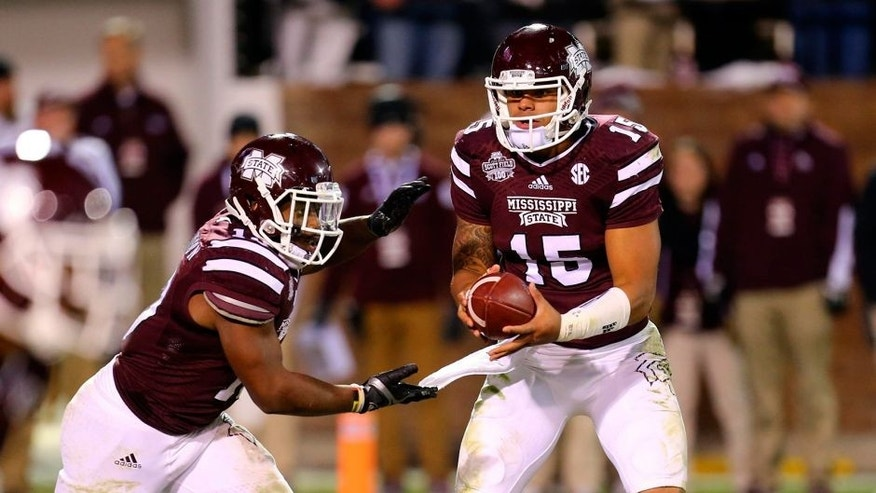 Nov 1, 2014; Starkville, MS, USA; Mississippi State Bulldogs quarterback Dak Prescott (15) hands the ball off to Mississippi State Bulldogs running back Josh Robinson (13) during the game against the Arkansas Razorbacks at Davis Wade Stadium. Mississippi State Bulldogs defeat the Arkansas Razorbacks 17-10. Mandatory Credit: Spruce Derden-USA TODAY Sports