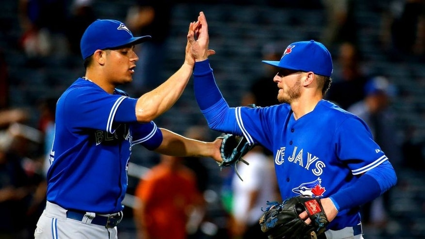 ATLANTA, GA - SEPTEMBER 17: Roberto Osuna #54 of the Toronto Blue Jays celebrates with Josh Donaldson #20 after their 5-0 win over the Atlanta Braves at Turner Field on September 17, 2015 in Atlanta, Georgia. (Photo by Kevin C. Cox/Getty Images)