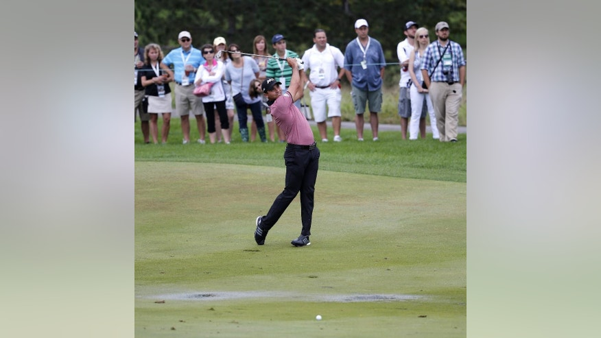 Jason Day, of Australia, watches his approach shot on the third fairway near standing water during the second round of the BMW Championship golf tournament at Conway Farms Golf Club, Friday, Sept. 18, 2015, in Lake Forest, Ill. (AP Photo/Charles Rex Arbogast)