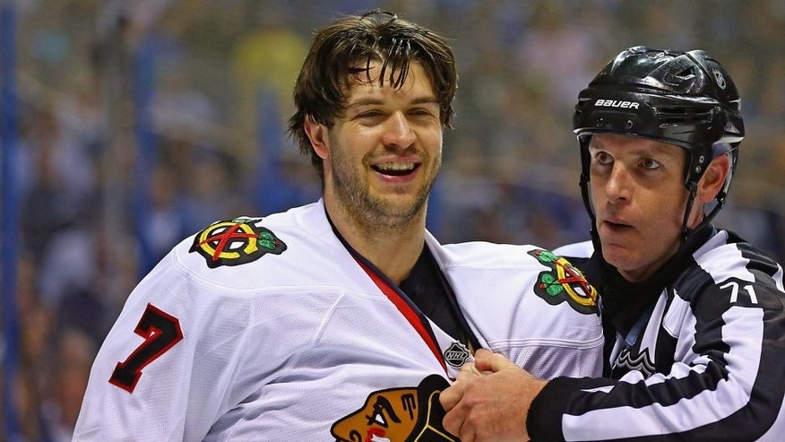 ST. LOUIS, MO - APRIL 19: Referee Brad Kovachick #71 restrains Brent Seabrook #7 of the Chicago Blackhawks who laughs after lying out David Backes #42 of the St. Louis Blues in Game Two of the First Round of the 2014 Stanley Cup Playoffs at the Scottrade Center on April 19, 2014 in St. Louis, Missouri. (Photo by Dilip Vishwanat/Getty Images)