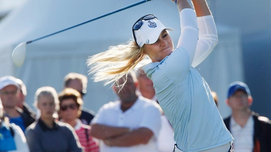 Europe's Anna Nordqvist of Sweden has hit the ball in the foursomes on Day1 of the Golf Solheim Cup in St.Leon-Rot, Germany, Friday, Sept. 18, 2015.(AP Photo/Michael Probst)
