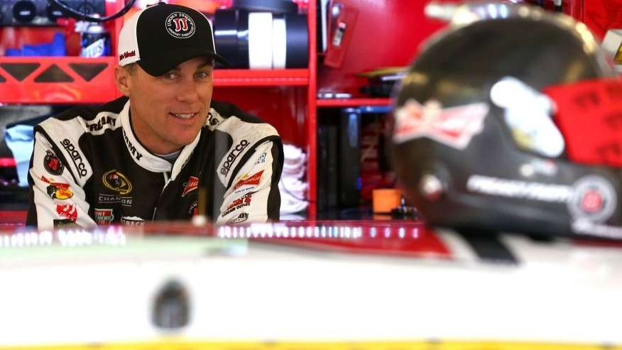 JOLIET, IL - SEPTEMBER 18: Kevin Harvick, driver of the #4 Jimmy John's / Budweiser Chevrolet, stands in the garage area during practice for the NASCAR Sprint Cup Series myAFibRisk.com 400 at Chicagoland Speedway on September 18, 2015 in Joliet, Illinois. (Photo by Sarah Crabill/NASCAR via Getty Images)