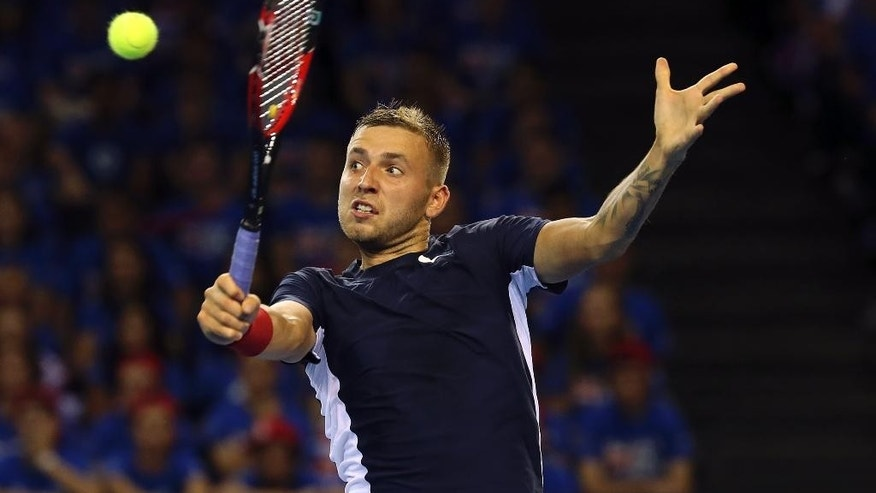 Britain's Dan Evans plays a return to Australia's Bernard Tomic during the semifinal tennis matches of the Davis Cup in Glasgow, Friday Sept. 18, 2015. (AP Photo/Scott Heppell)