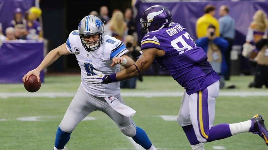 Detroit Lions quarterback Matthew Stafford (left) is sacked by Minnesota Vikings defensive end Everson Griffen during the second half. The Vikings won 14-13.